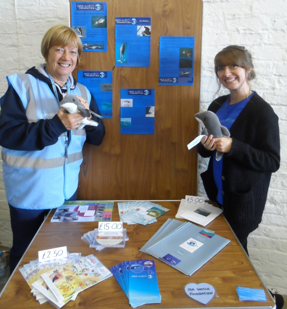 Friends of the Estuary volunteer Meg Green modelling our fluffy dolphins with Stacey