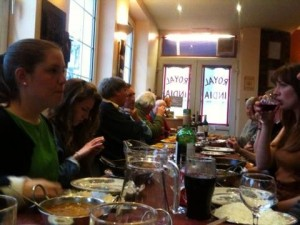 Staff, interns, trustees and regional coordinators enjoying a meal together
