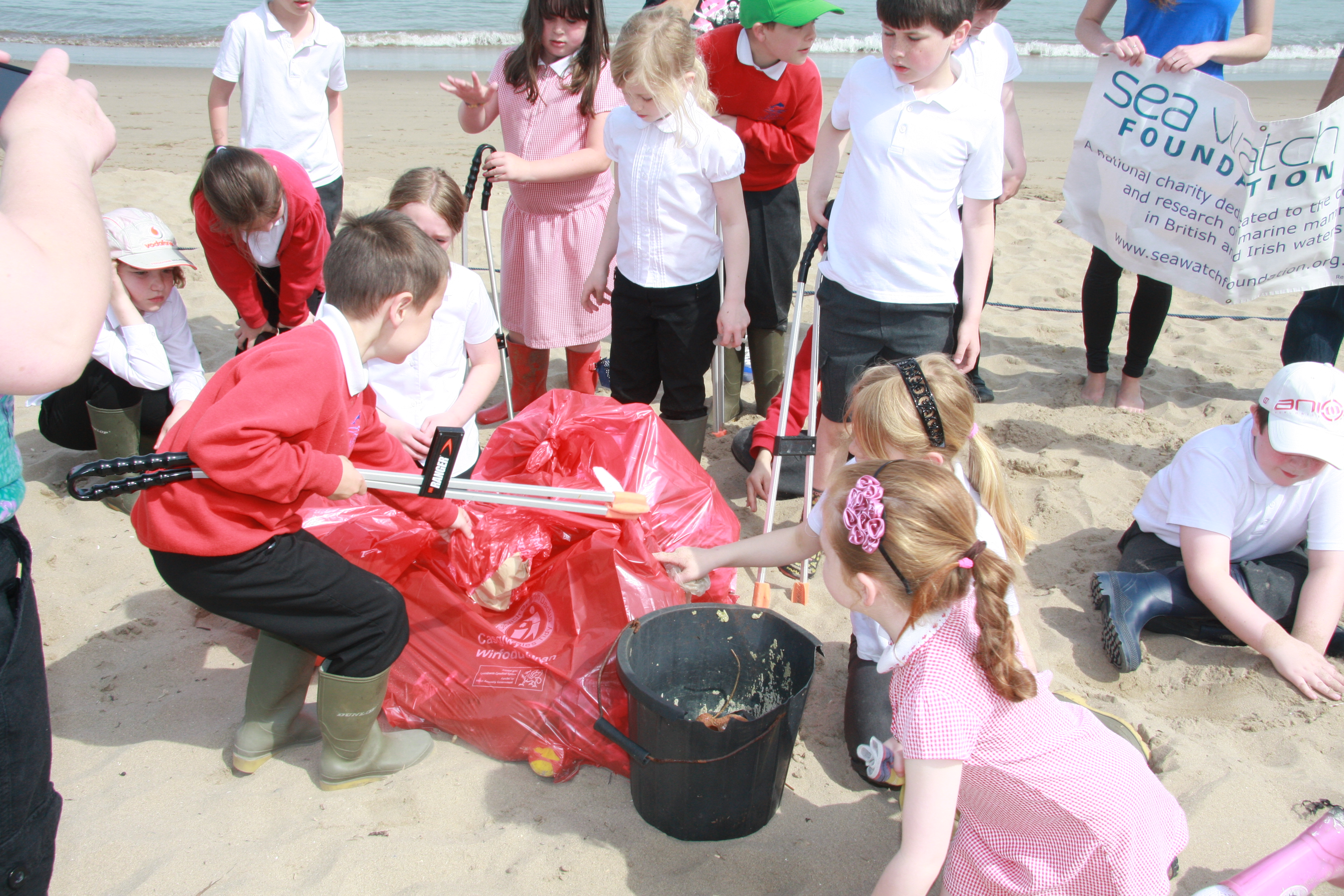 A Sea Watch beach clean with local school children.